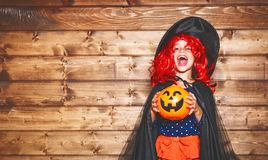 Funny child girl in witch costume in halloween Royalty Free Stock Photos