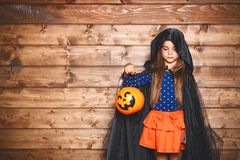 Funny child girl in witch costume in halloween Royalty Free Stock Images
