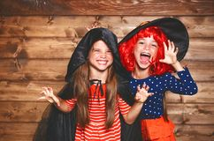 Funny children sister twins girl in witch costume in halloween Royalty Free Stock Photos