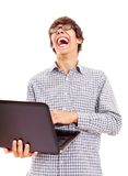 Laughing funny guy with laptop royalty free stock photo
