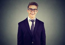 Laughing funny looking handsome businessman in glasses Stock Image