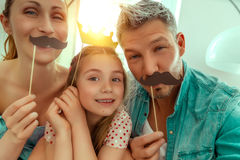 Laughing funny parents with daughter. Happy family fun making selfie royalty free stock photo