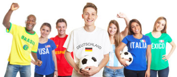 Laughing german soccer with blond hair with fans from other countries Royalty Free Stock Images