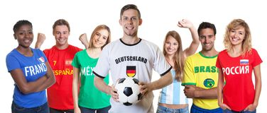 Laughing german soccer fan with cheering group of other fans royalty free stock image