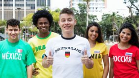 Laughing german sports fan with supporters from Mexico, Brazil,. Colombia and Russia outdoors on way to stadium Stock Photo