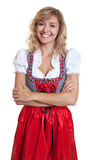 Laughing german woman with crossed arms in a traditional bavarian dirndl Stock Photography