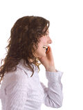 Laughing girl. Cute young brunette girl speaking over the cellphone. Isolated over white Stock Photography