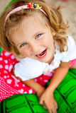 Laughing girl. Girl with blue eyes laughing and looking up - straight to the camera stock photos