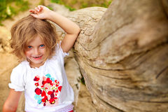 Laughing girl. Girl with blue eyes smiling and looking straight to the camera royalty free stock photos