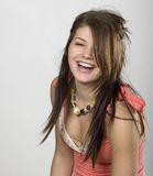 Laughing Girl. Candid photo of teenage girl laughing Stock Photo