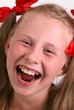 Laughing girl. With red fillets in hair Stock Photography