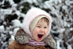 Laughing girl. 2years old girl portrait in winter clothing Stock Image