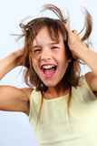 Laughing girl. With tousled hair Stock Photos