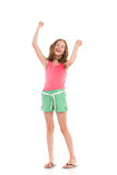 Laughing girl with arms raised Stock Images