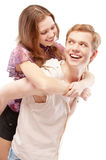 Laughing girl astride young man Stock Photo