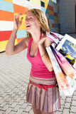 Laughing girl with bags Stock Photography