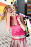 Laughing girl with bags Royalty Free Stock Image