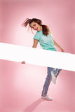 Laughing girl holding a long blank banner Royalty Free Stock Photos