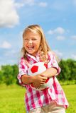 Laughing girl with ball Royalty Free Stock Photography