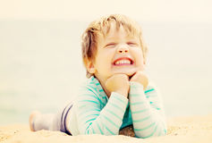 Laughing girl  on  beach Royalty Free Stock Image