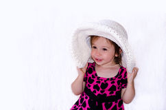 Laughing girl with big hat royalty free stock photography