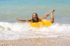 Laughing girl in bikini on inflatable ring Royalty Free Stock Image