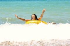 Laughing girl in bikini on inflatable ring Stock Photos