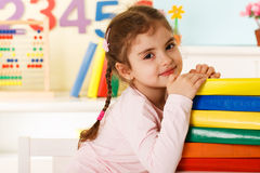Laughing girl with books Stock Photography