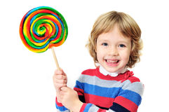 Laughing girl with candy Stock Photos