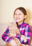 Laughing girl and cat Royalty Free Stock Photography
