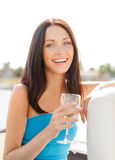 Laughing girl with champagne glass Royalty Free Stock Photos