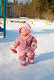 The laughing girl on a children's playground. In the winter Stock Photography