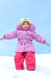 Laughing girl dressed in winter clothes Royalty Free Stock Photo