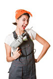 Laughing girl with drill Stock Image