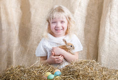 Laughing girl with Easter bunny Stock Images