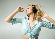 Laughing girl enjoying the realaxing music Stock Images