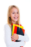 Laughing girl with exercise books Stock Photos