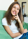 Laughing girl with finger in nose Stock Images