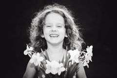 Laughing girl with a flower in her hand. Black and white photo. Stock Photo