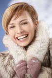 Laughing girl in fur coat Stock Photos