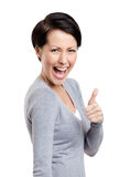 Laughing girl gives thumb up Royalty Free Stock Image