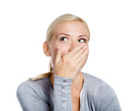 Laughing girl covers mouth with hand Royalty Free Stock Photo