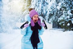 The laughing girl is happy in the winter, playing in the snow. stock images