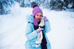 The laughing girl is happy in the winter, playing in the snow. royalty free stock photos