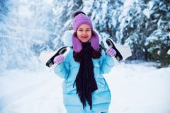 The laughing girl is happy in the winter, playing in the snow. stock photo