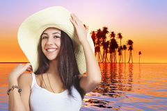 Laughing girl in hat Stock Images