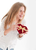 Laughing girl with heart shaped box Stock Photos