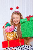 Laughing girl holding presents Stock Images