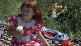 Laughing girl with ice-cream stock footage