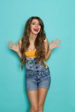 Laughing Girl In Jeans Dungarees Stock Images